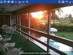 Spectacular sunset as seen from the screened porch overlooking pool and golf course.