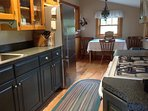 Fully-equipped kitchen with gas stove, microwave, coffee maker, pot, pans, dishes, utensils...