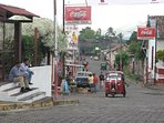 The small town of Masatepe with the mototaxi, also driving on the dirt road next to the park.
