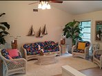 Living room- Spacious, high cathedral ceilings, professionally furnished & decorated in island style