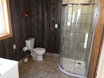Bathroom overview featuring reclaimed barn board accenting this three piece bathroom.