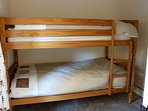 This bedroom has a full size double bunk bed.