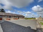 There is plenty of gravelled parking to the front of the pair of cottages