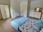 Large double bedroom with plenty of room, wardrobe and chest of drawers, also a folding bed available for a child