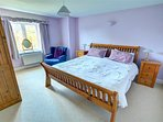 Large spacious bedroom, includes a king size bed and bedside cabinets