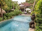 private 9 m swimming pool set in a lush tropical garden