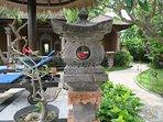 Balinese lanterns throughout gardens for evening illumination.