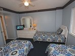 Let the Kids or Guests Wind Down after a Fun Filled Beach Day in this Lovely Guest Bedroom 3 Twin Beds, Flat Screen...