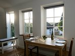 Your dining table looks out over the garden to the South Downs.