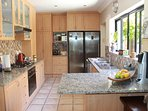 Open plan kitchen open to dining area with Fridge, Freezer and Gas Hob with electric Oven