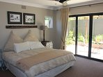 Main Bedroom with sliding doors onto private patio area