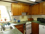 Country kitchen, with electric cooker, fridge, frezzer, washing machine, microwave, kettle, toaster