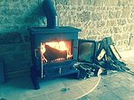 The wonderful large wood  burning stove will warm you up on those cooler evenings