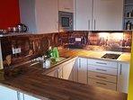 kitchen, microwave, ceran field, refridgerator,  toaster, dishes, coffee & tea for free