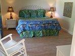 Master Bedroom - King-sized Beautyrest mattress, down pillows & comforter, wicker furniture, TV.