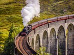 Watch out for the Jacobite steam train from the window, here it is over Glenfinnan viaduct