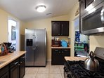 Bright Kitchen has high-end Stainless appliances with 5-burner gas stove/oven.