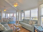 Enjoy spectacular waterfront views from the plush couch in the inviting living room.