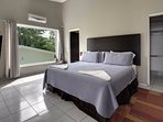 King bedroom with en-suite bath and large screen TV with air conditioned rooms