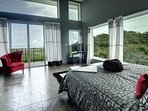 Large picture windows and private balcony in the master bedroom for amazing views