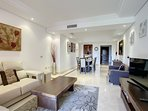Spacious lounge with satellite TV