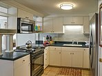The first kitchen hosts new stainless steel appliances.