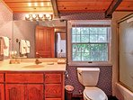 Freshen up in this pristine bathroom.