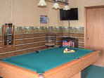 The game room has a cable TV as well, plus access to one of the outdoor decks