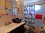 Nautical BA has tub/shower with privacy curtain