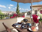 The gorgeous balcony offering breathtaking views of the Paphos hills