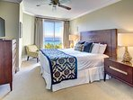 First master bedroom features a sumptuous king-size bed