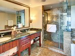 The second master bathroom with granite vanity, walk-in shower, and soaking tub