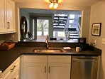 new leathered granite kitchen looking to golf course view