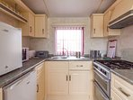 Spacious kitchen area with modern layout at California Cliffs Holiday Park.