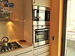 KITCHEN WITH ALL COMFORT, DISH MACHINE,OVEN AND MICROWAVE OVEN