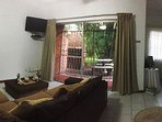 Lounge area with flat screen TV with selected Hotel DSTV Cannels
