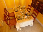 Table in entry hall set for dinner