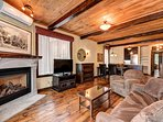 In the living room there is comfortable furnishings, a satellite television and a gas fireplace