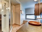 The super modern bathroom offers both, a walk-in shower and a bath tub