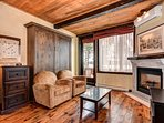 The condo features beautiful wooden floors, and rustic decor and furnishings