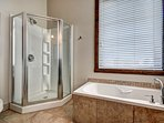 The super modern bathroom offers both, a walk-in shower and a bath tub