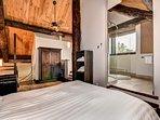 The open-concept mezzanine features a sumptuous queen-sized bed