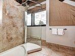 Large, glass-enclosed shower