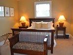 Master bedroom on the first floor, queen beds