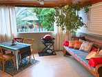 Large covered balcony to relax, cook, dine