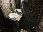 Upper Floor Blue Room bathroom with shower. The tiles are anti-slippery