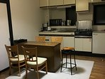 Kitchen / Dining - Range, Microwave, Coffee, Water Pot, Rice Cooker, Fridge, Crockery, Dinnerware