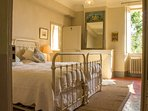 A smartly-presented, cosy double room with en-suite marble shower room, garden view, wardrobe, desk