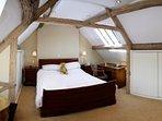 Feature bedroom with exposed original beams.  Antique mahogany bedroom furniture, Ensuite bathroom