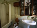 Victorian Full Bathroom in the room. Pedestal sink, Claw foot tub, shower.